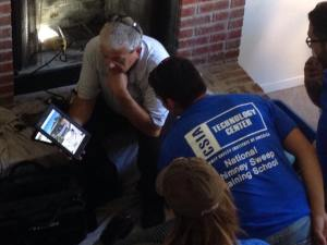 CSIA Certified Chimney Sweep Joe Sauter shows one of the students photos that had been taken of the home.