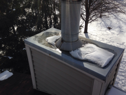 """Chimney chase cover is concave and holding water. Suggest replacement with a stainless steel chase cover with the proper breaks for drainage."""