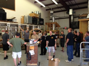 Students of the National Chimney Sweep Training School learn about new tools in June 2015.