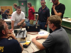 Students in CSIA's troubleshooting gas hearth appliances couse work on equipment in the classroom in July 2015.