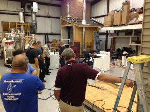 Students enrolled in the 2-day Certified Dryer Exhaust Technician course take apart a residential clothes dryer during the July 2015 course.